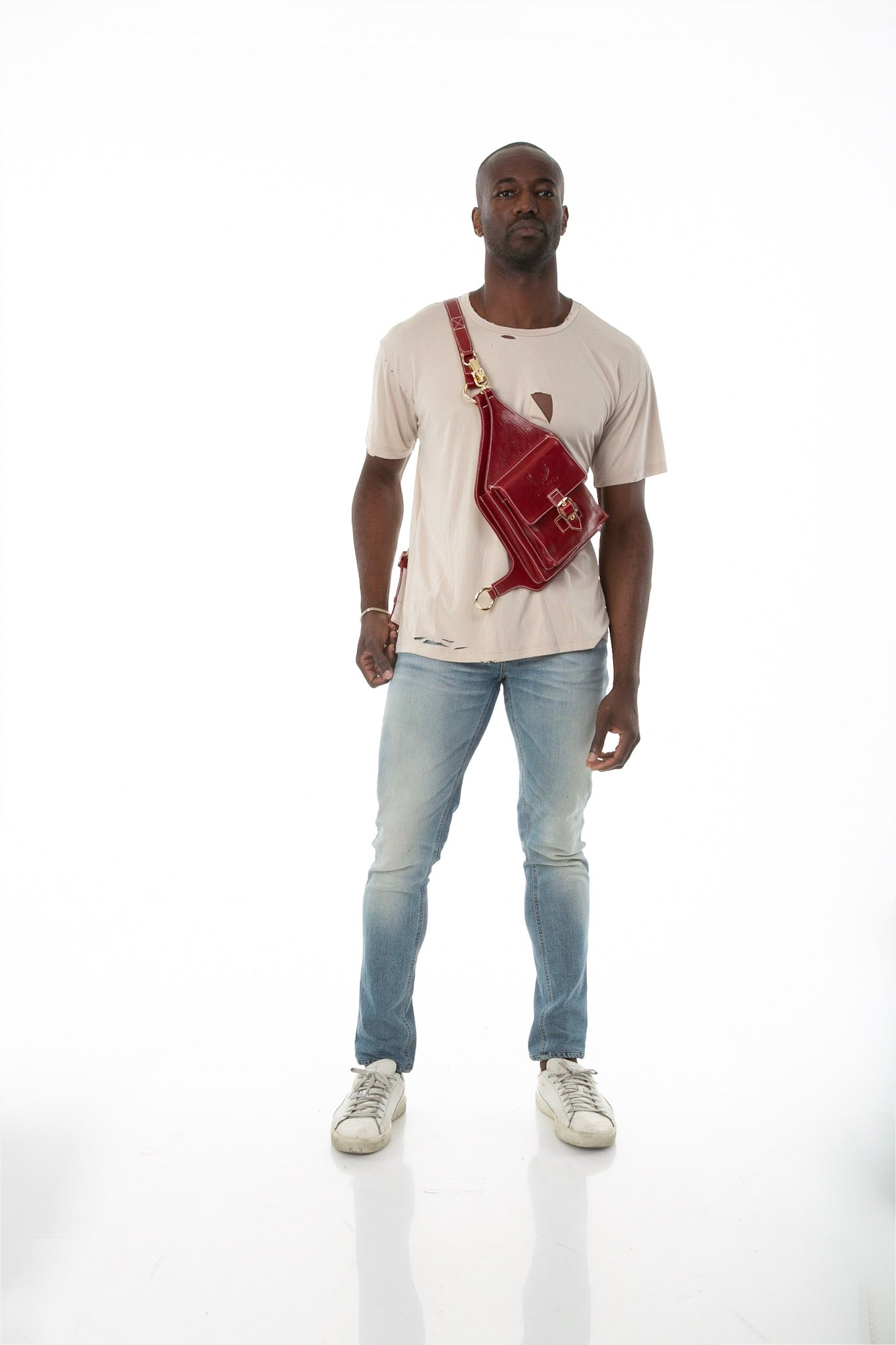 Front of male model wearing Holster Bag in Red