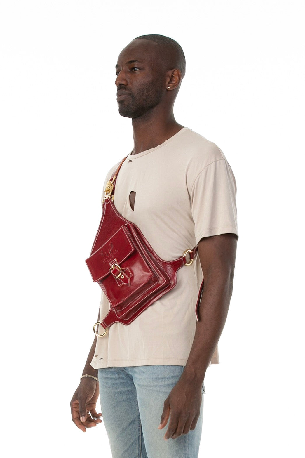 Side of male model wearing Holster Bag in Red