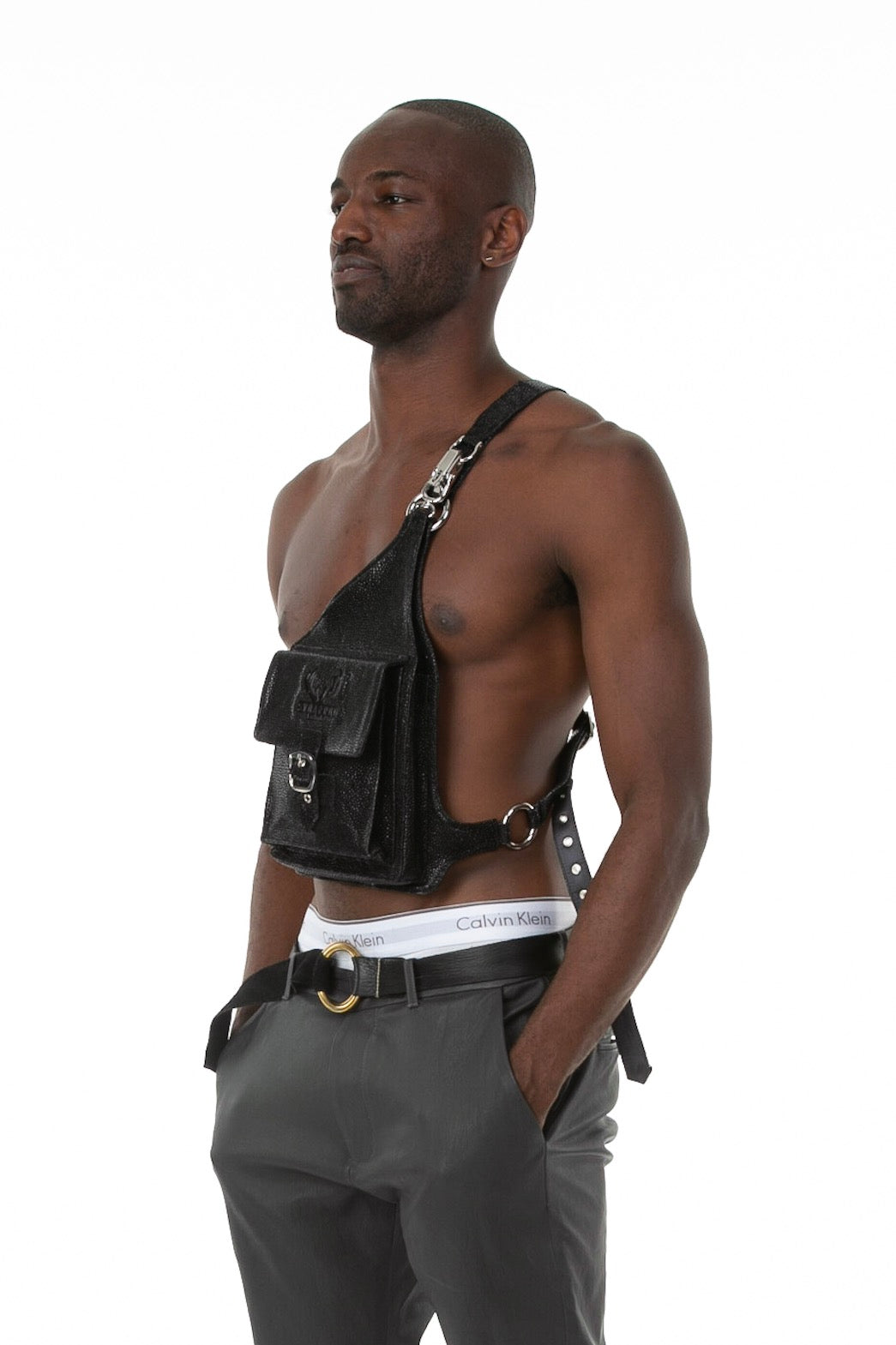 Side of male model wearing Holster Bag in Stingray