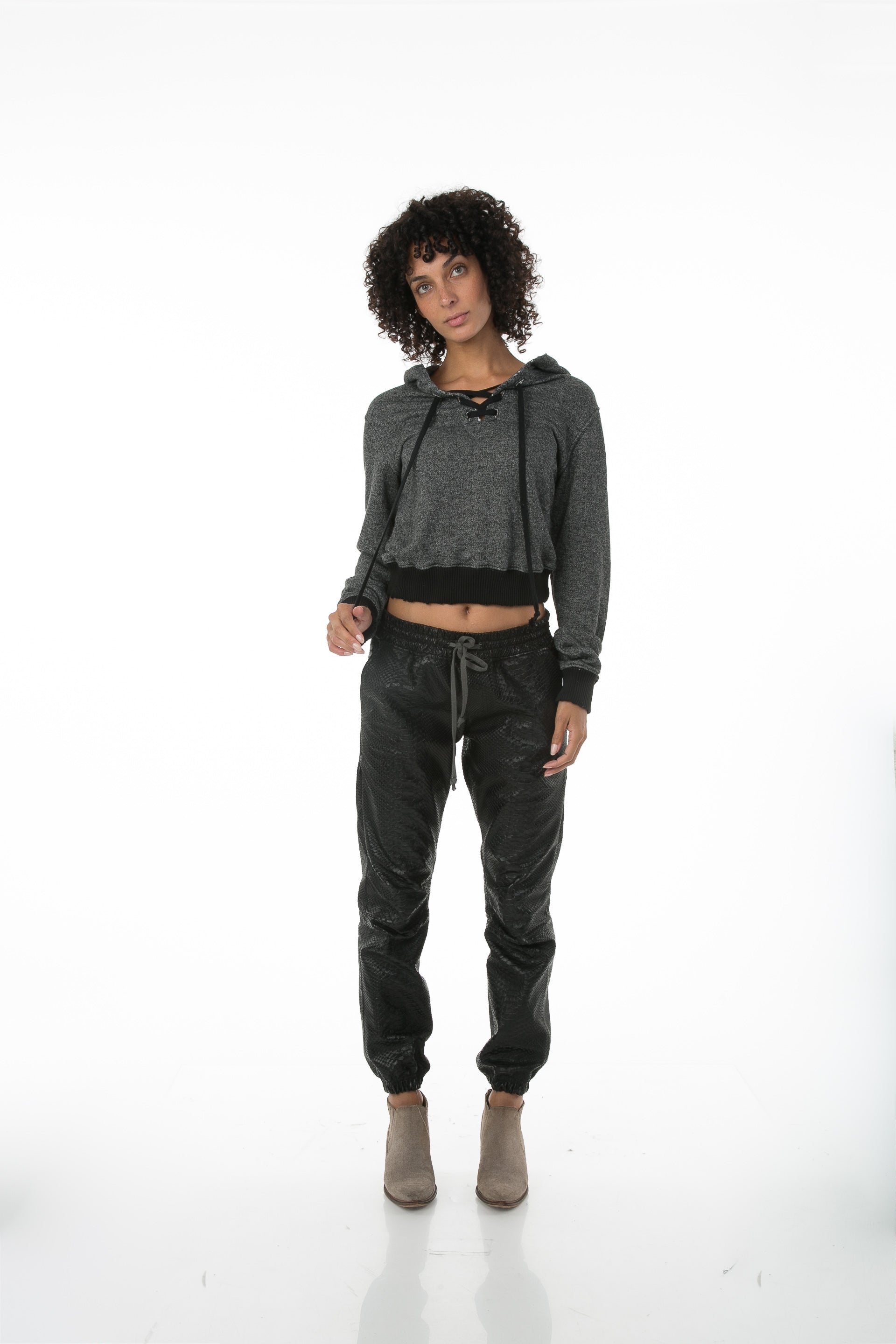 Front of female model wearing Cropped Hoodie in Black