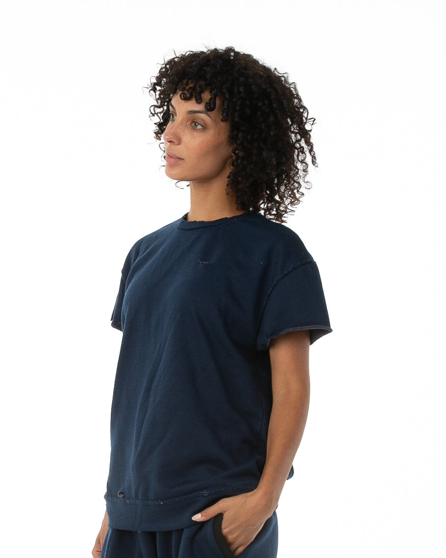 Side of female model wearing Terry Cutoff in Navy