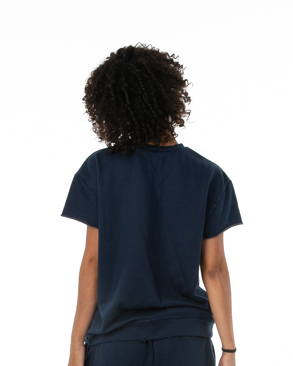 Back of female model wearing Terry Cutoff in Navy