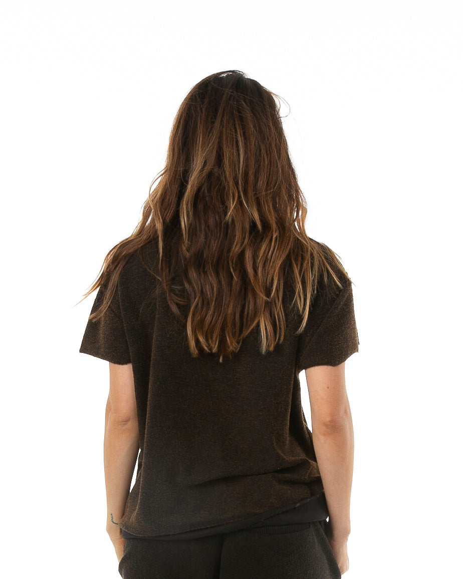 Backside of female model wearing Terry Cutoff in Black