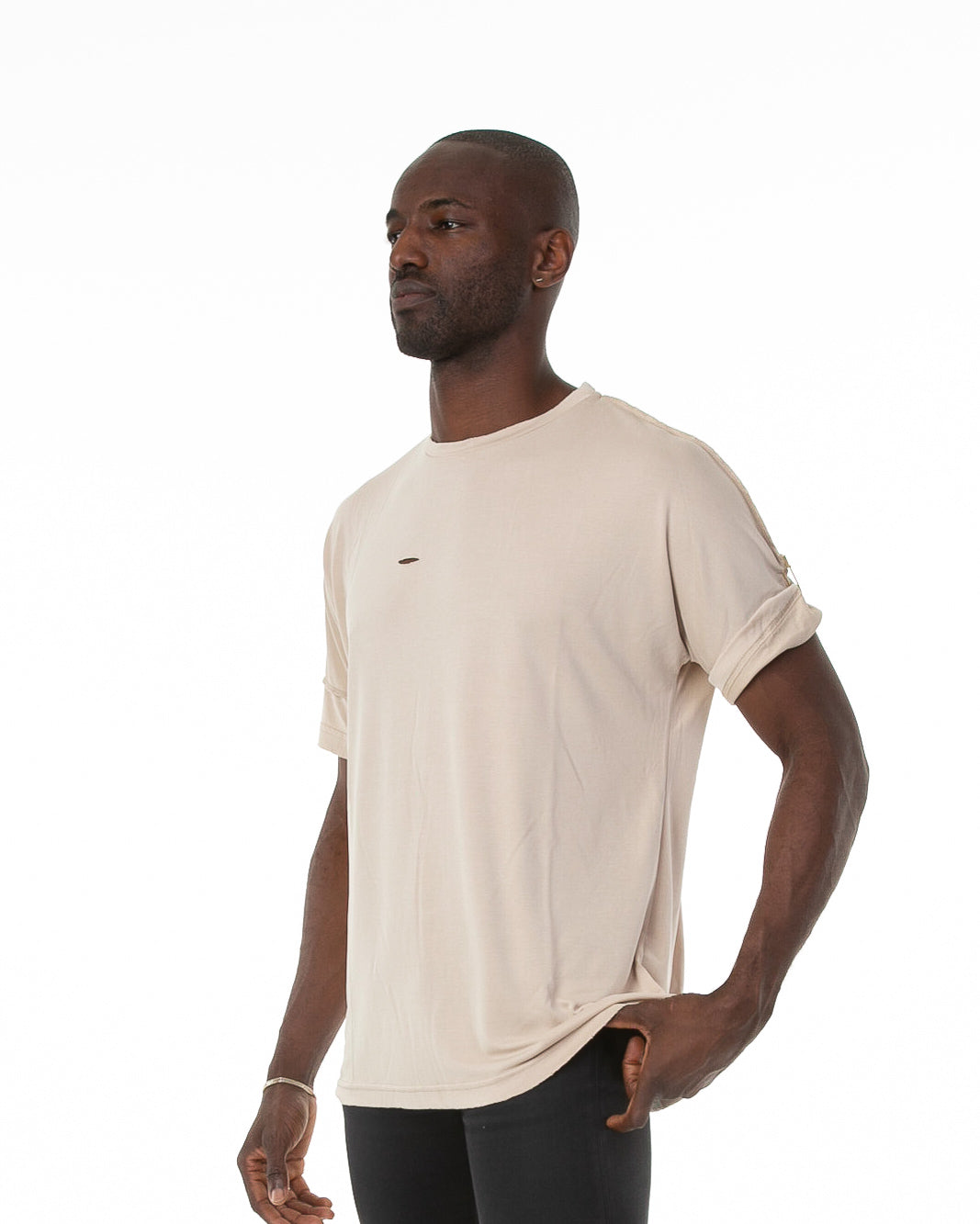 Side of male model wearing Run Tee in Natural