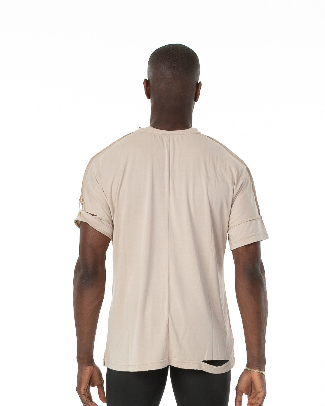 Backside of male model wearing Run Tee in Natural