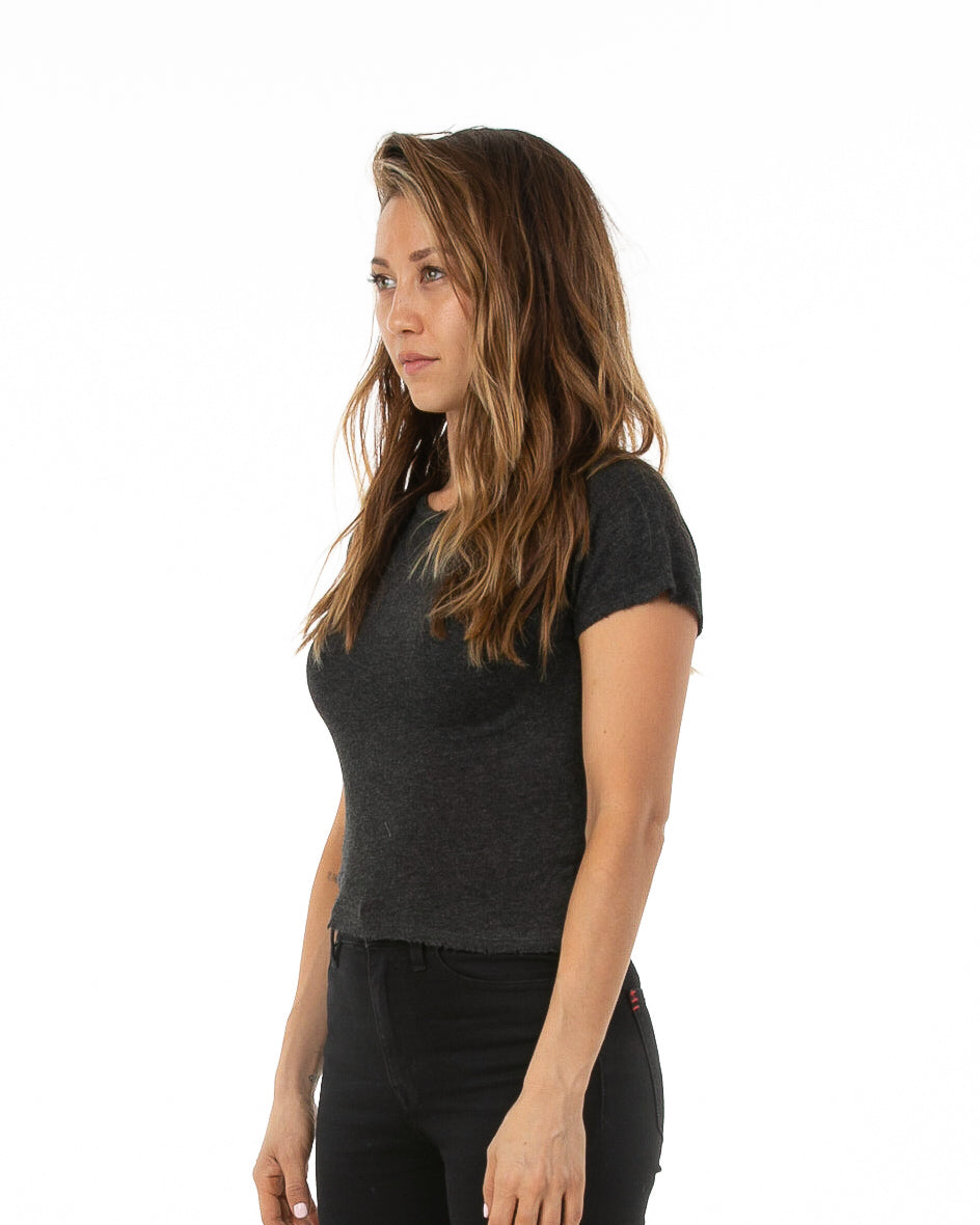 Side of female model wearing Boxy Tee in Charcoal