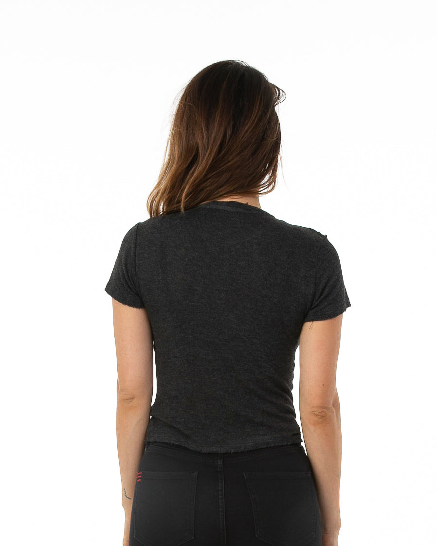 Backside of female model wearing Boxy Tee in Charcoal