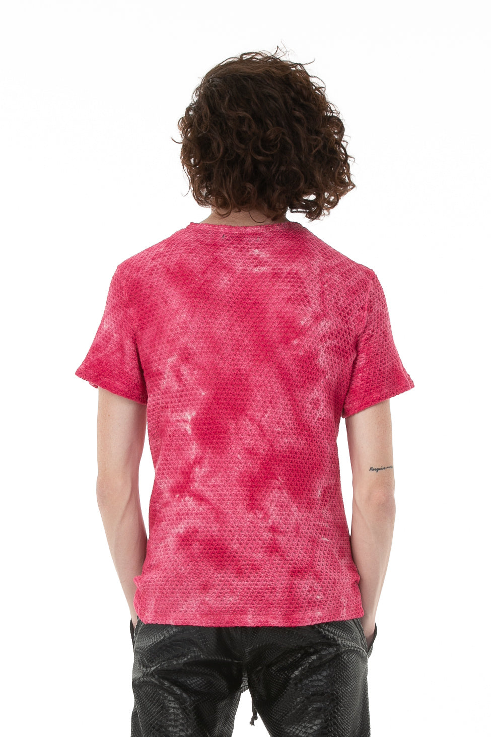 Backside of male model wearing Pointelle Tee in Washed Pink