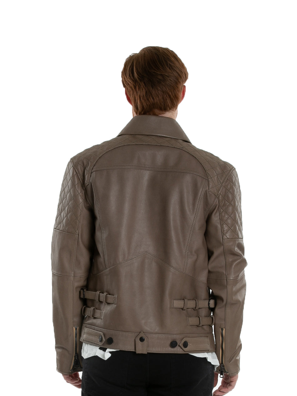 Backside of male model wearing Grindstone leather jacket