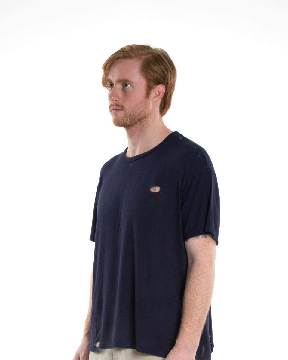Side of male model wearing Hand-stitched Tee in Navy