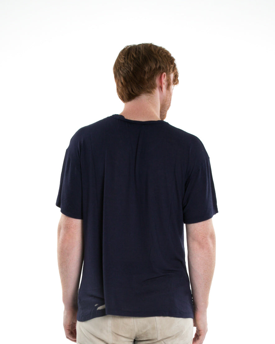 Backside of male model wearing Hand-stitched Tee in Navy