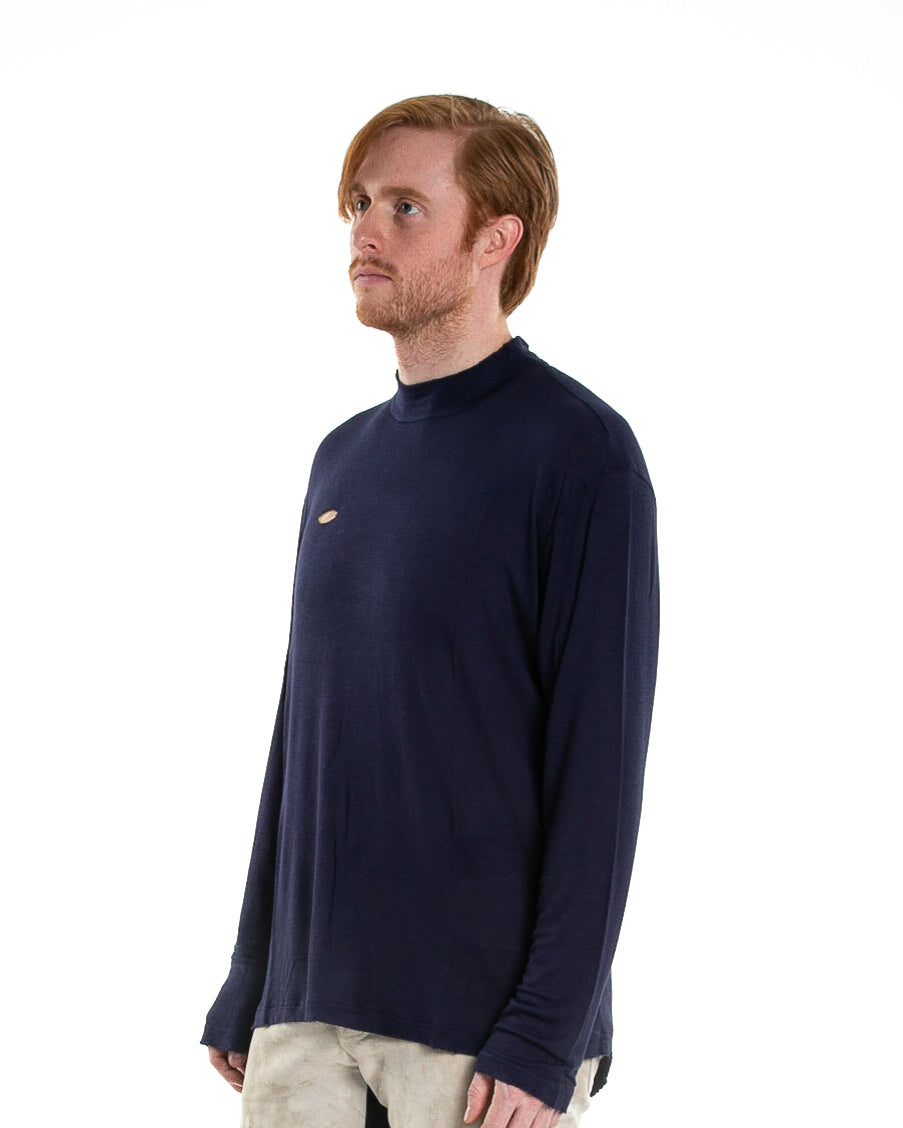 Side of male model wearing of Merchant Long Sleeve in Navy