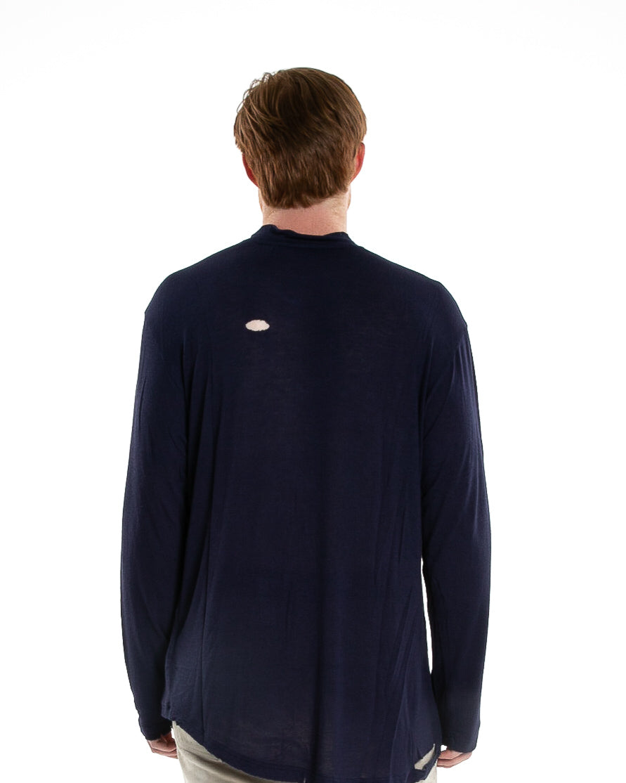 Backside of male model wearing of Merchant Long Sleeve in Navy