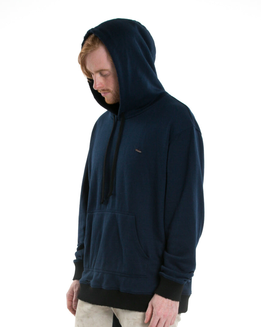 Side of male model wearing Weighted Hoodie in Navy