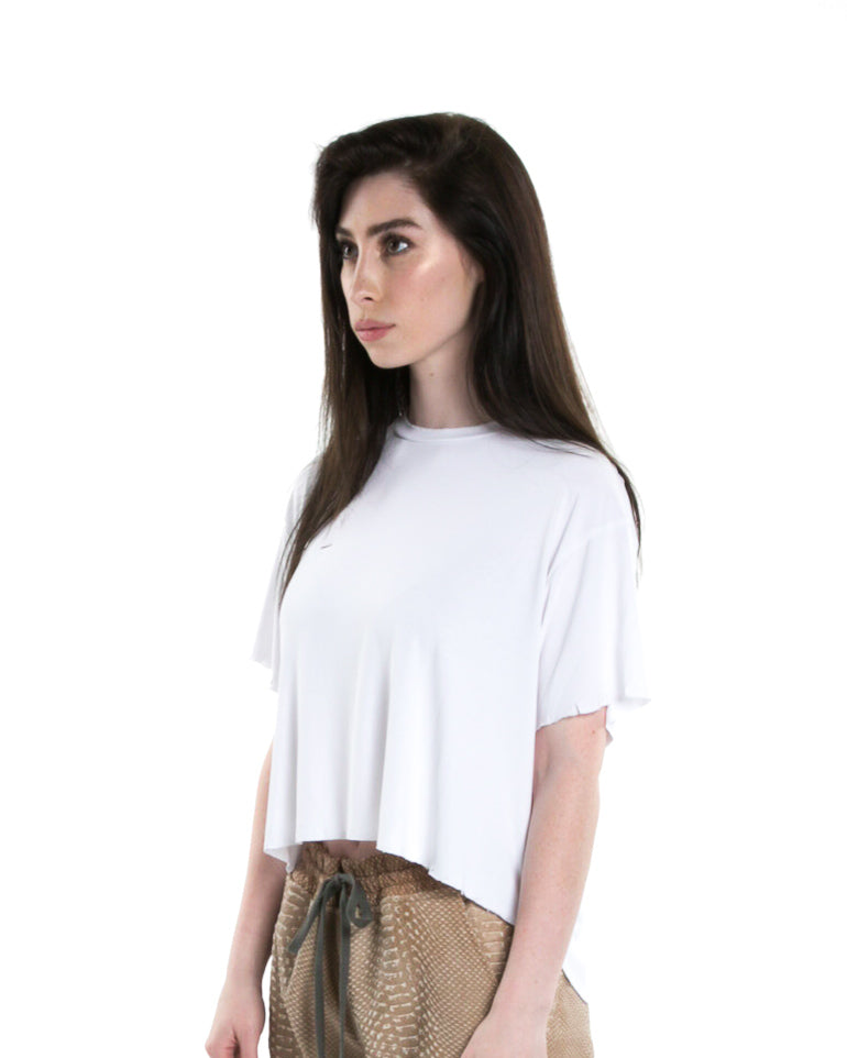 Side of female model wearing Cropped Tee in White