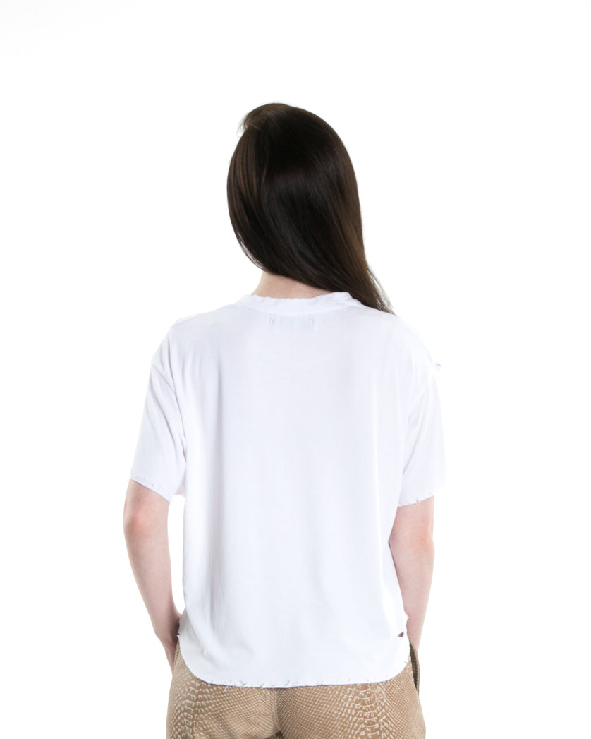 Backside of female model wearing Cropped Tee in White