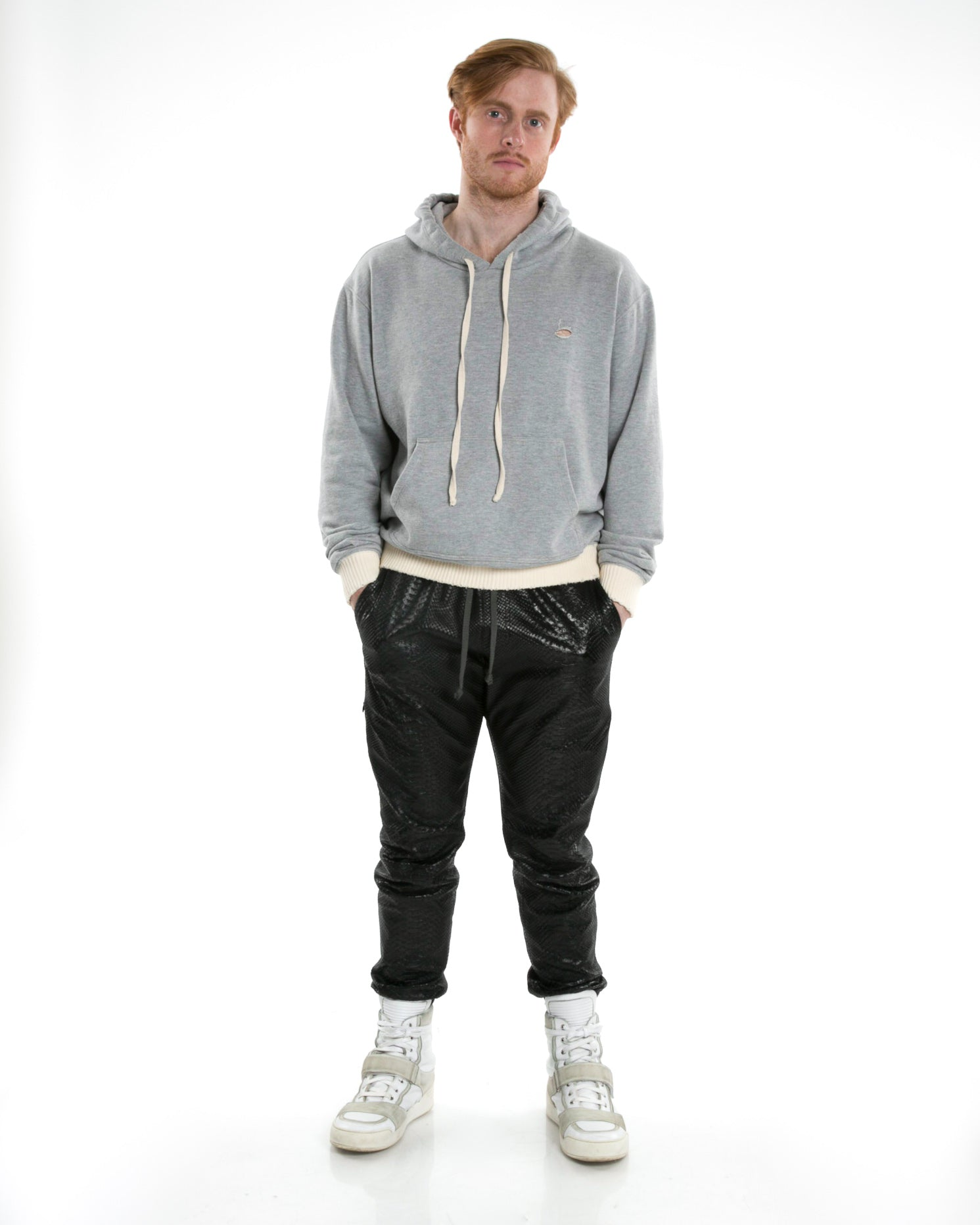 Front of male model wearing Weighted Hoodie in Heather Grey