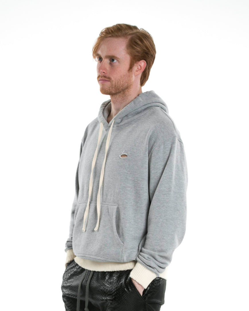 Side of male model wearing Weighted Hoodie in Heather Grey
