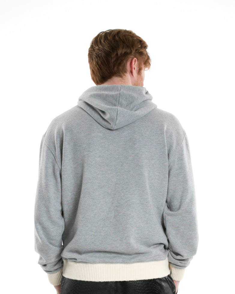 Back of male model wearing Weighted Hoodie in Heather Grey