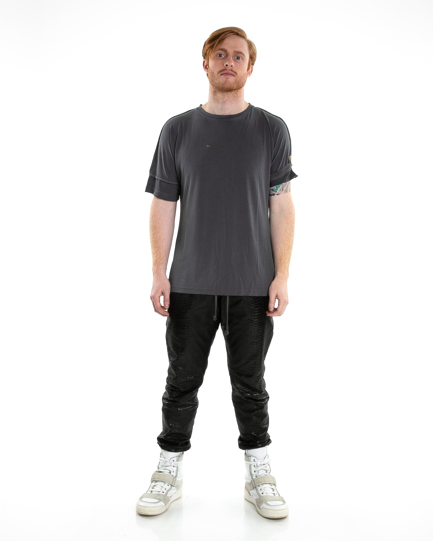 Front of male model wearing Run Tee in Charcoal