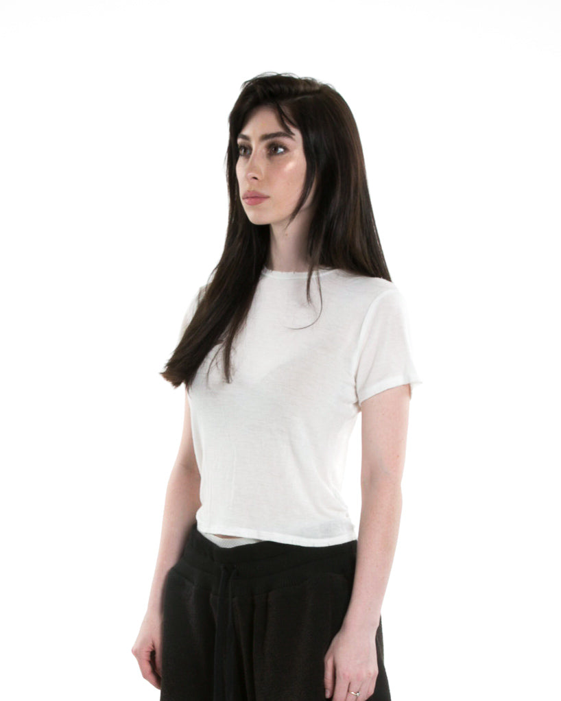 Side of female model wearing Boxy Tee in Ivory