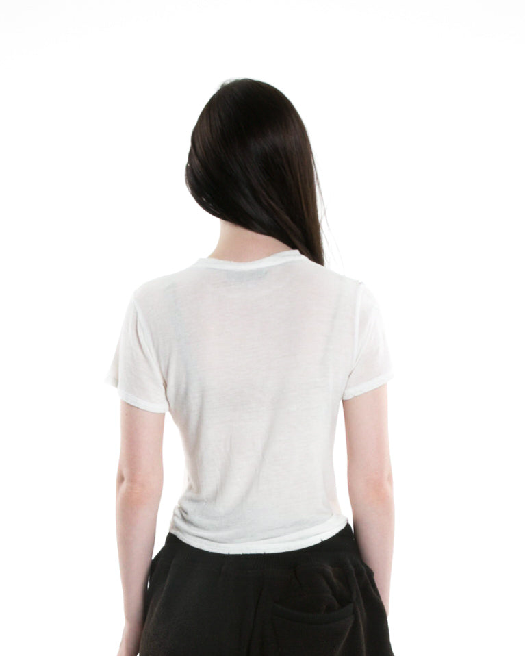 Back of female model wearing Boxy Tee in Ivory