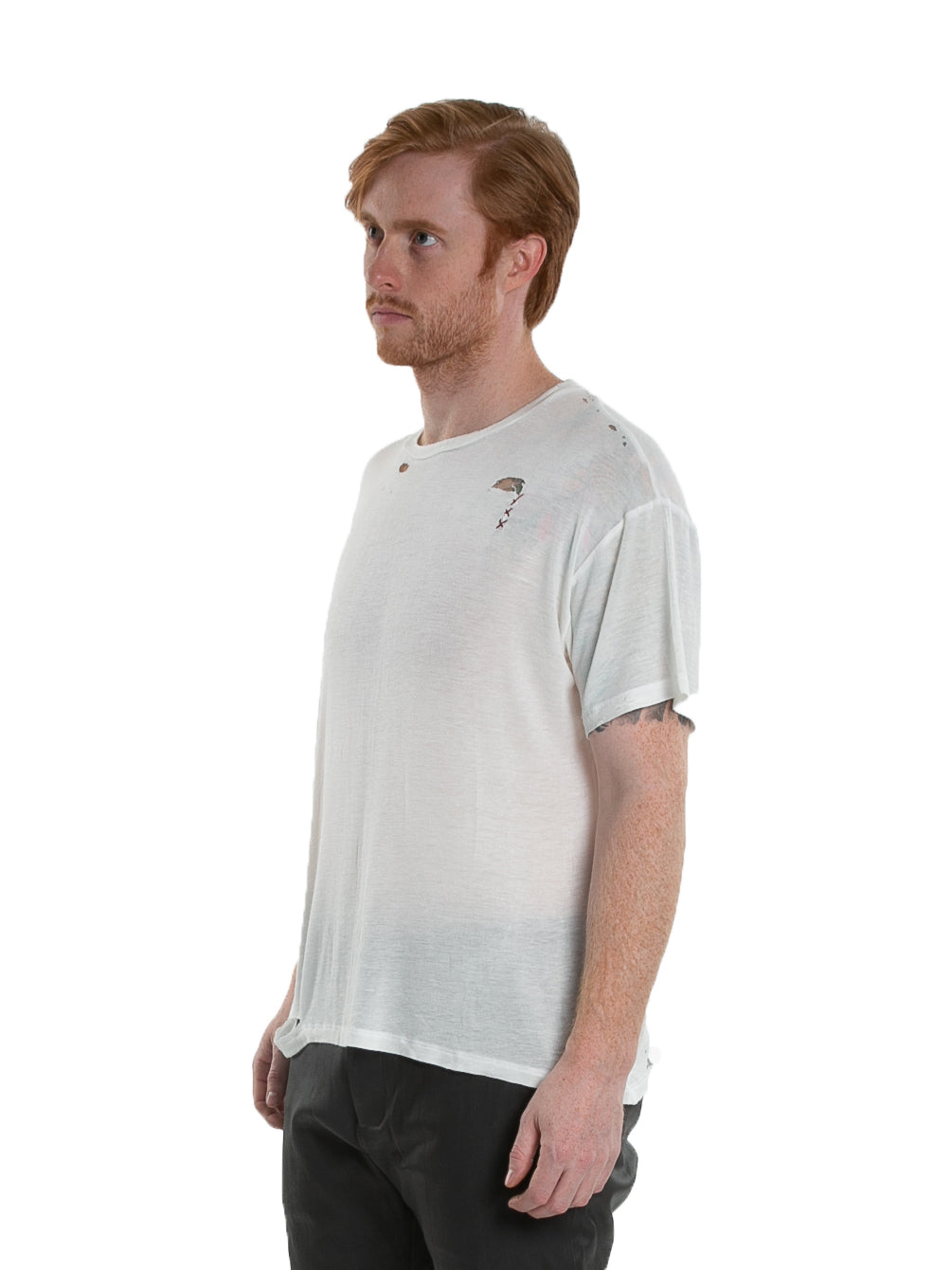 Side of male model wearing Hand-stitched Tee in Ivory