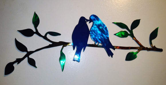 Blue Birds Sitting on a Twig