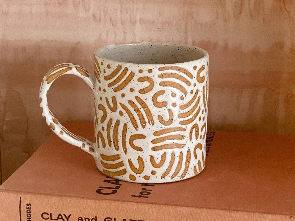 Handmade ceramic mug in speckled clay, glazed with white hand-painted dash wax resist pattern