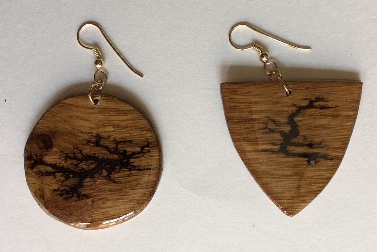 wood with burn patterns non matching earrings