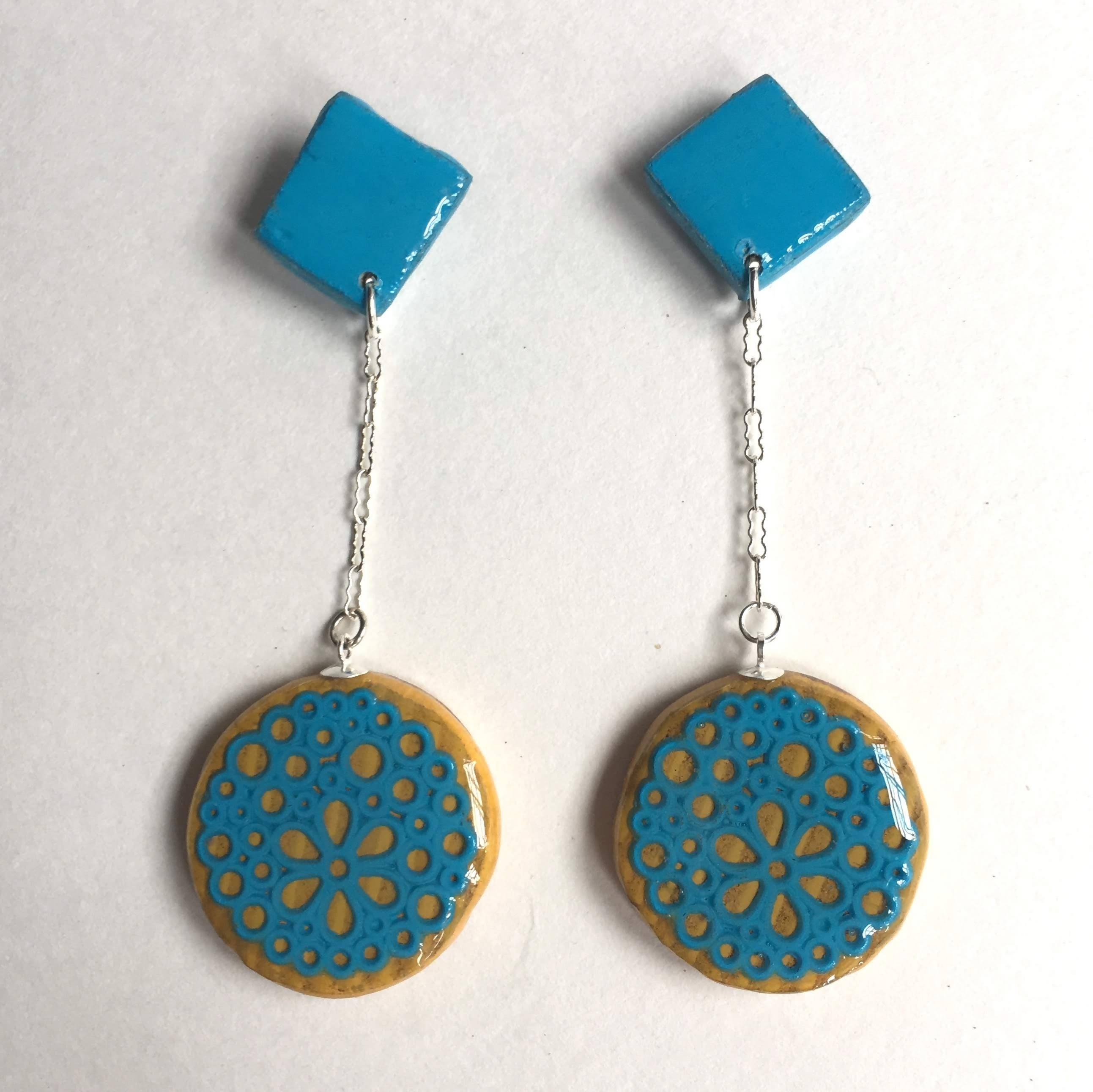 flower circles suspended from square post earrings