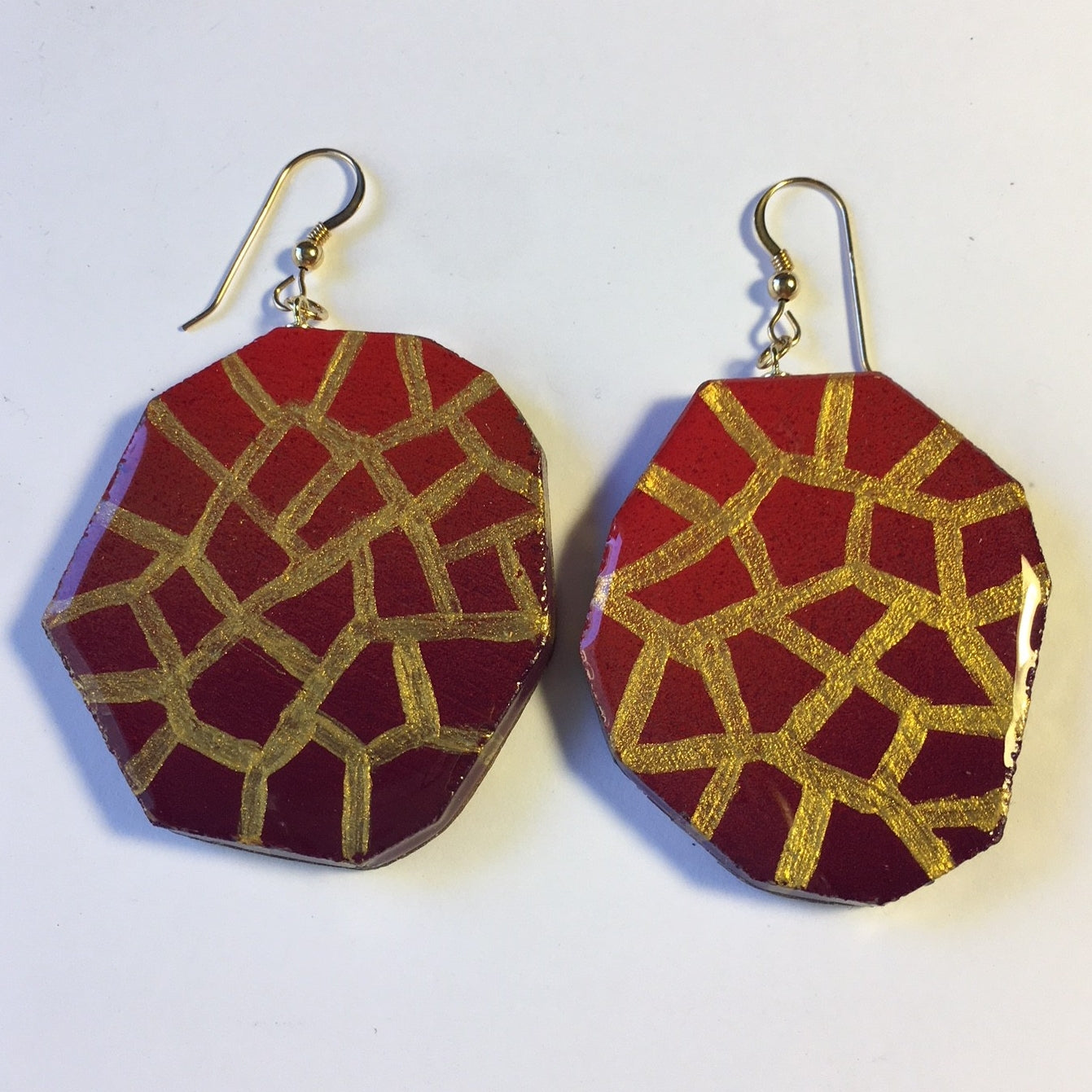 geometric shape with purple , orange, and gold on top