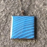 blue square in brass , rings of the tree