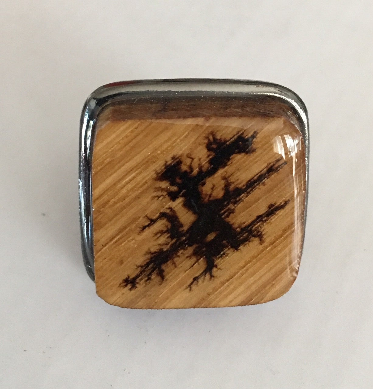 black square ring base with burnt wood