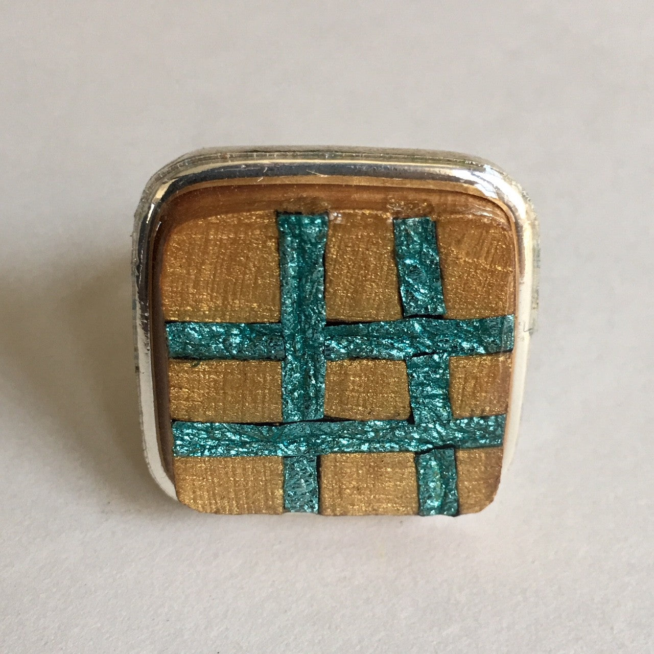 silver ring with gold and blue silver stripes