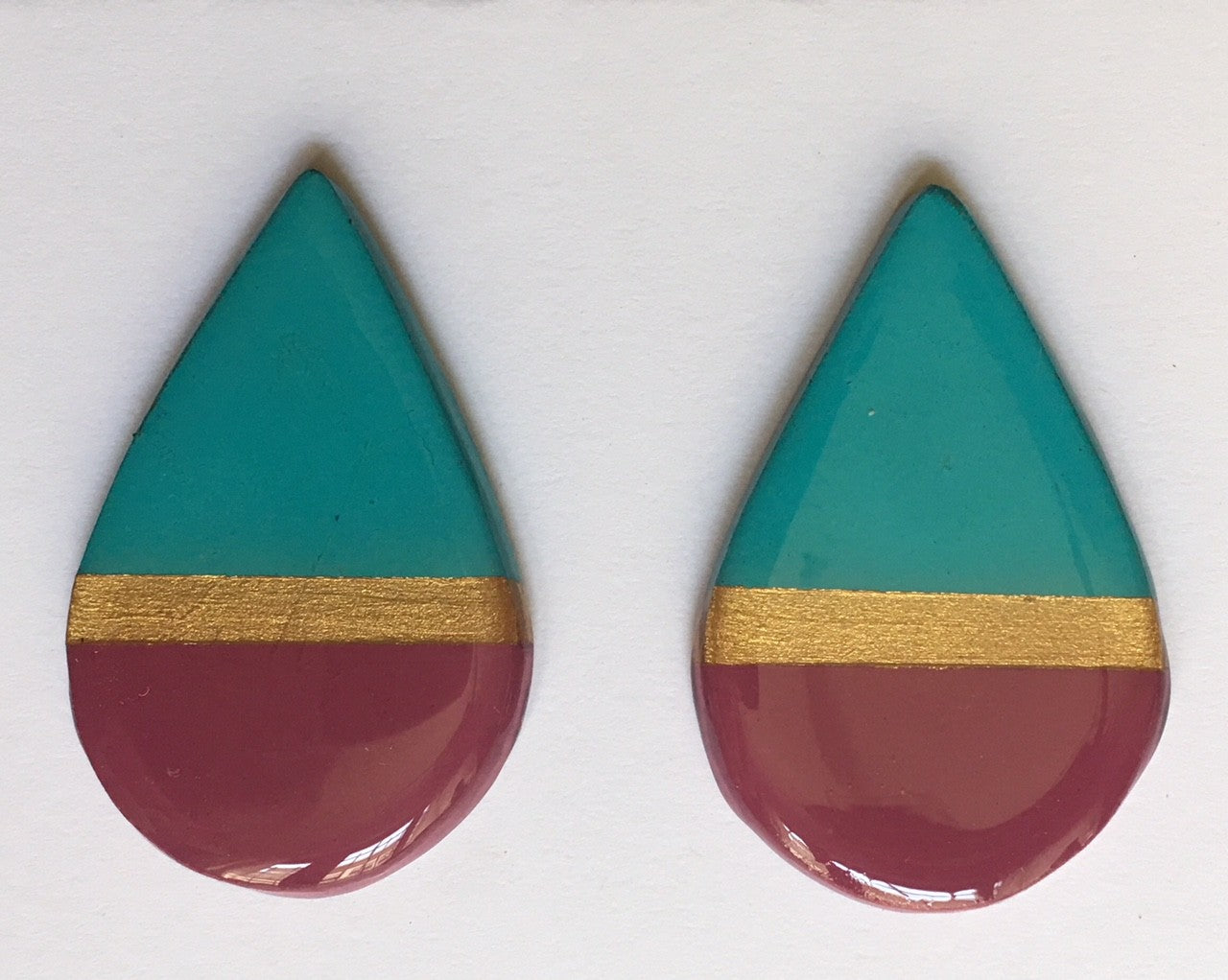 large tear drop magenta blue and gold -post