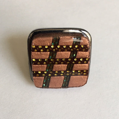 black square ring with copper colored squares
