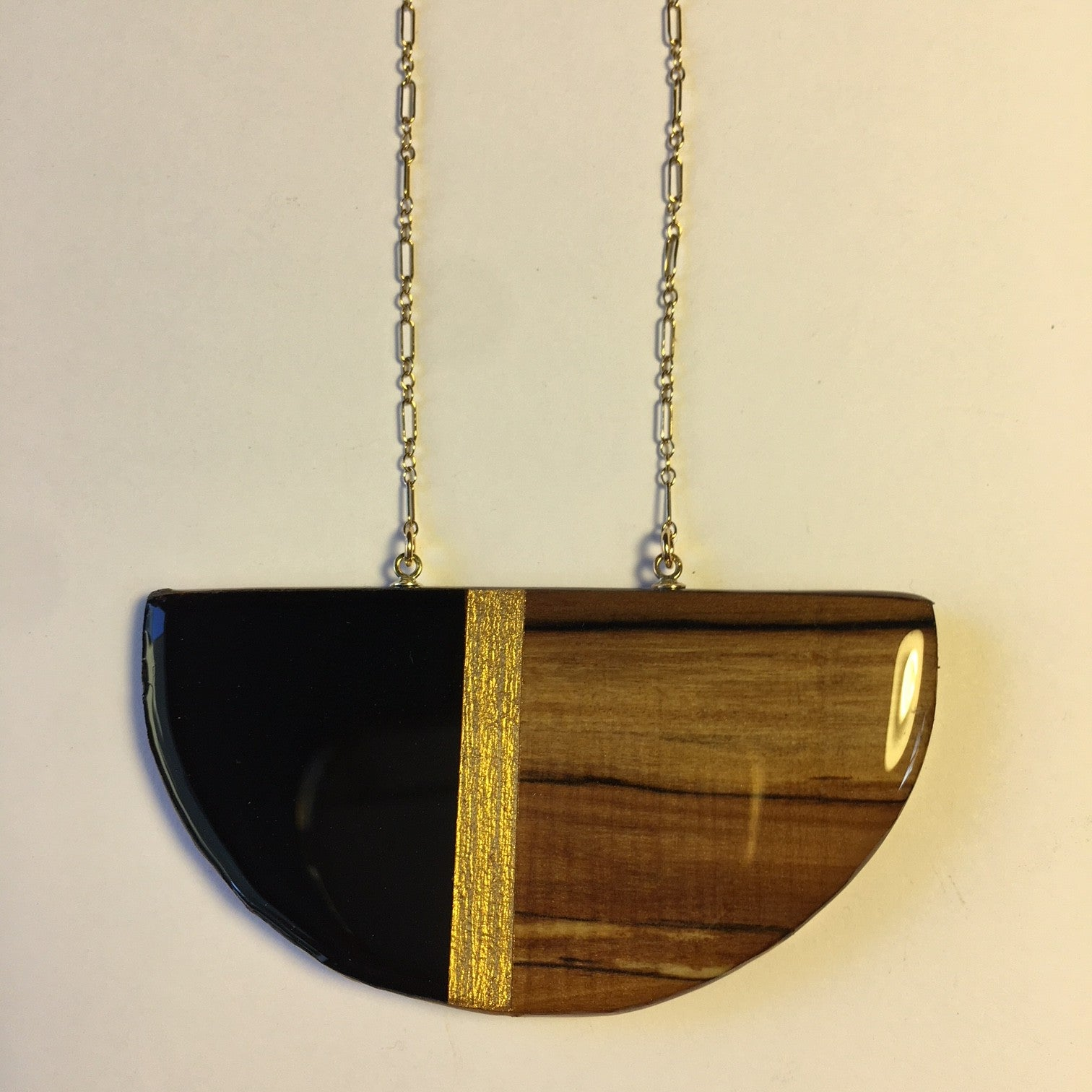 half circle with black, gold and wood