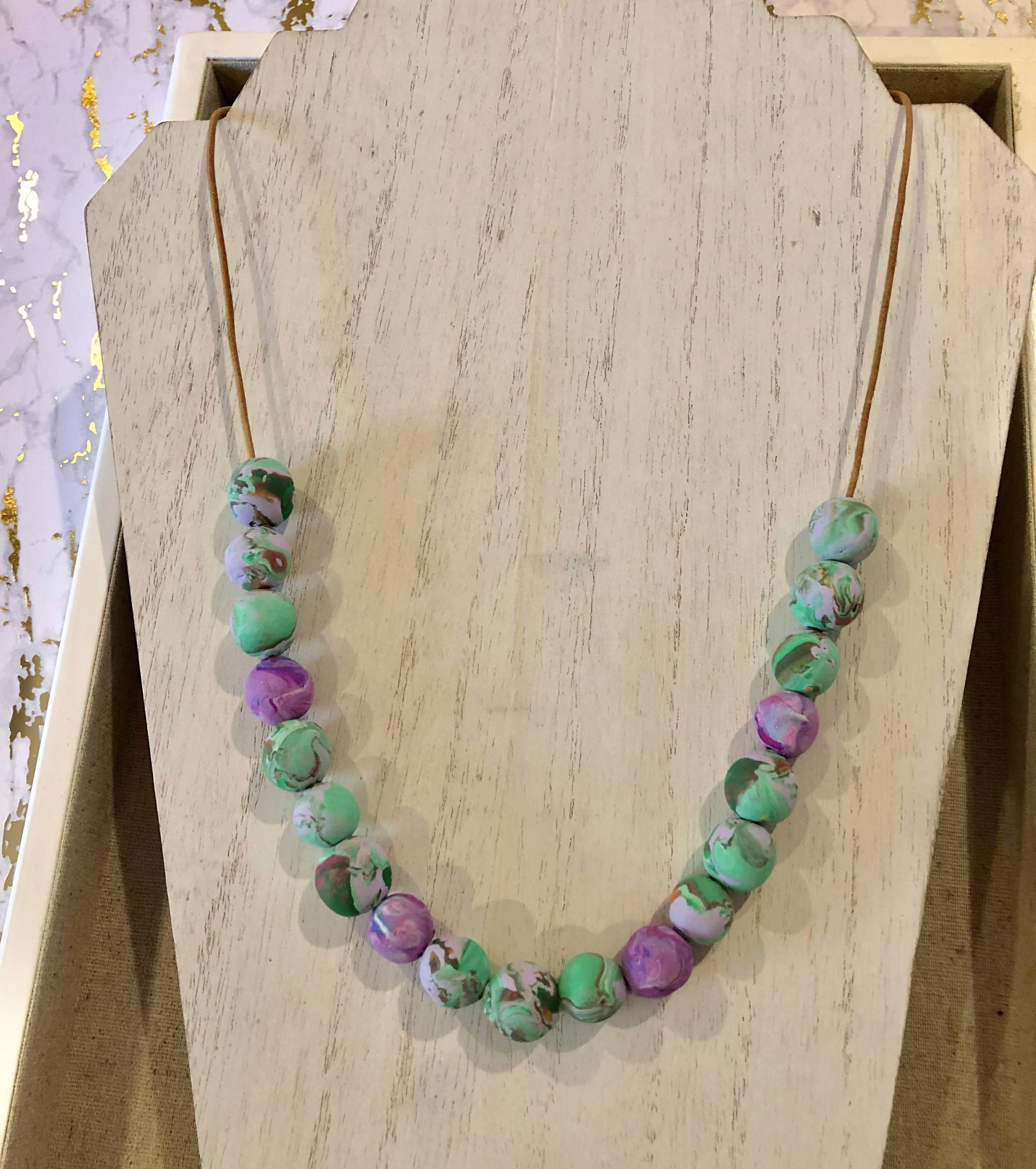 swirly whirly bead necklace on leather