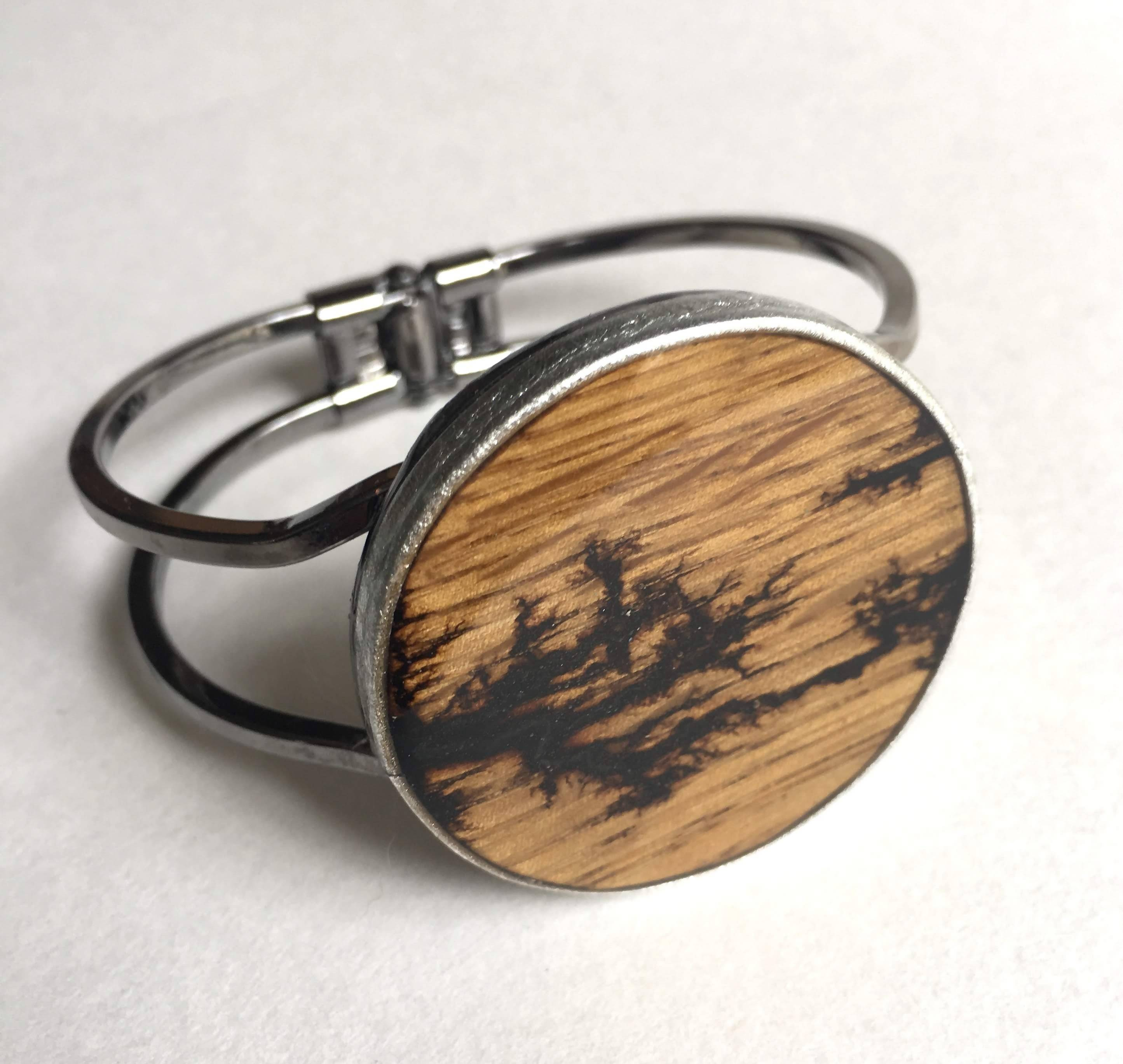 wood burn cuff with silver leather band