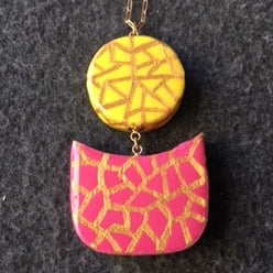 yellow/gold circle, fushia/gold cup- chain attached