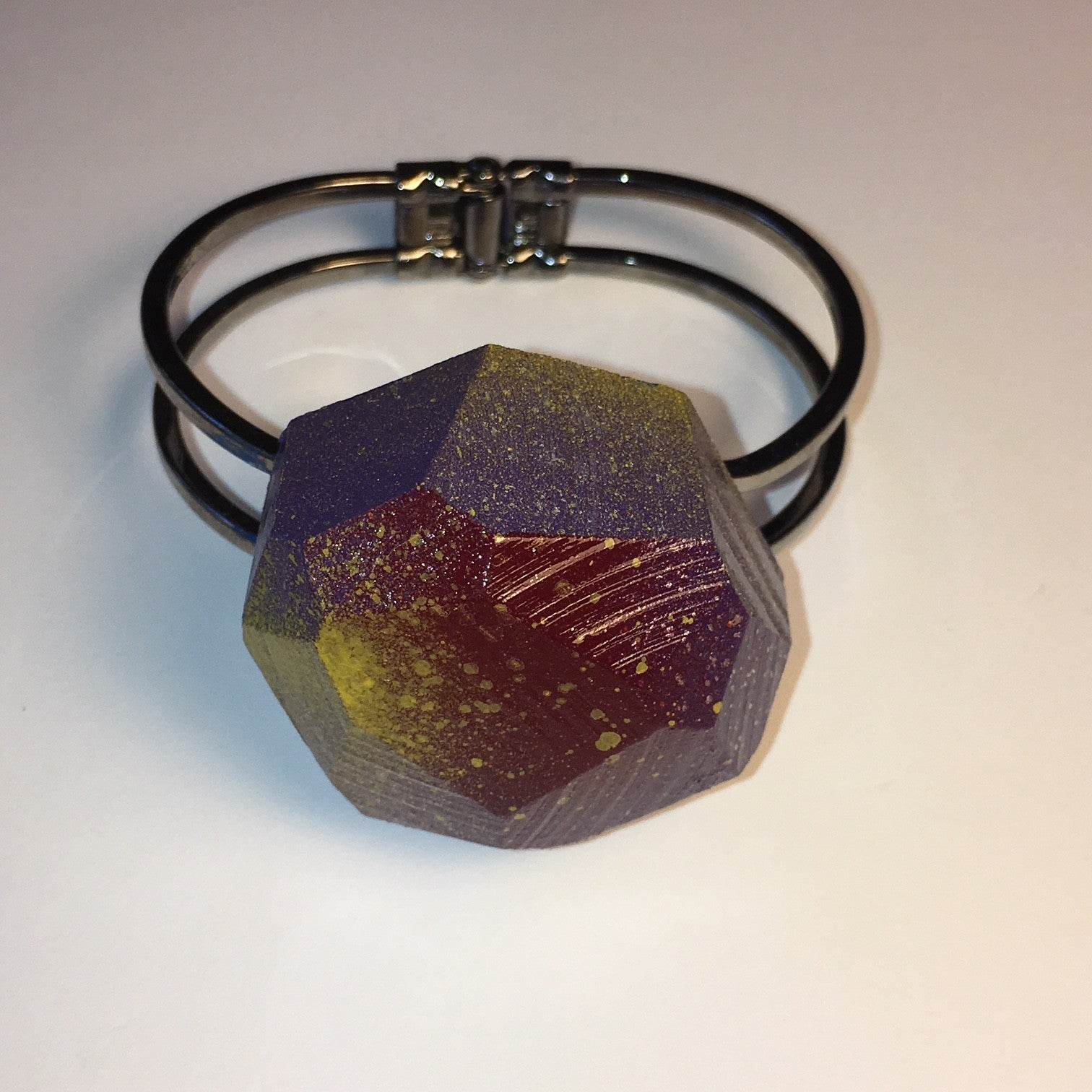 black cuff with short faceted multi colored wood