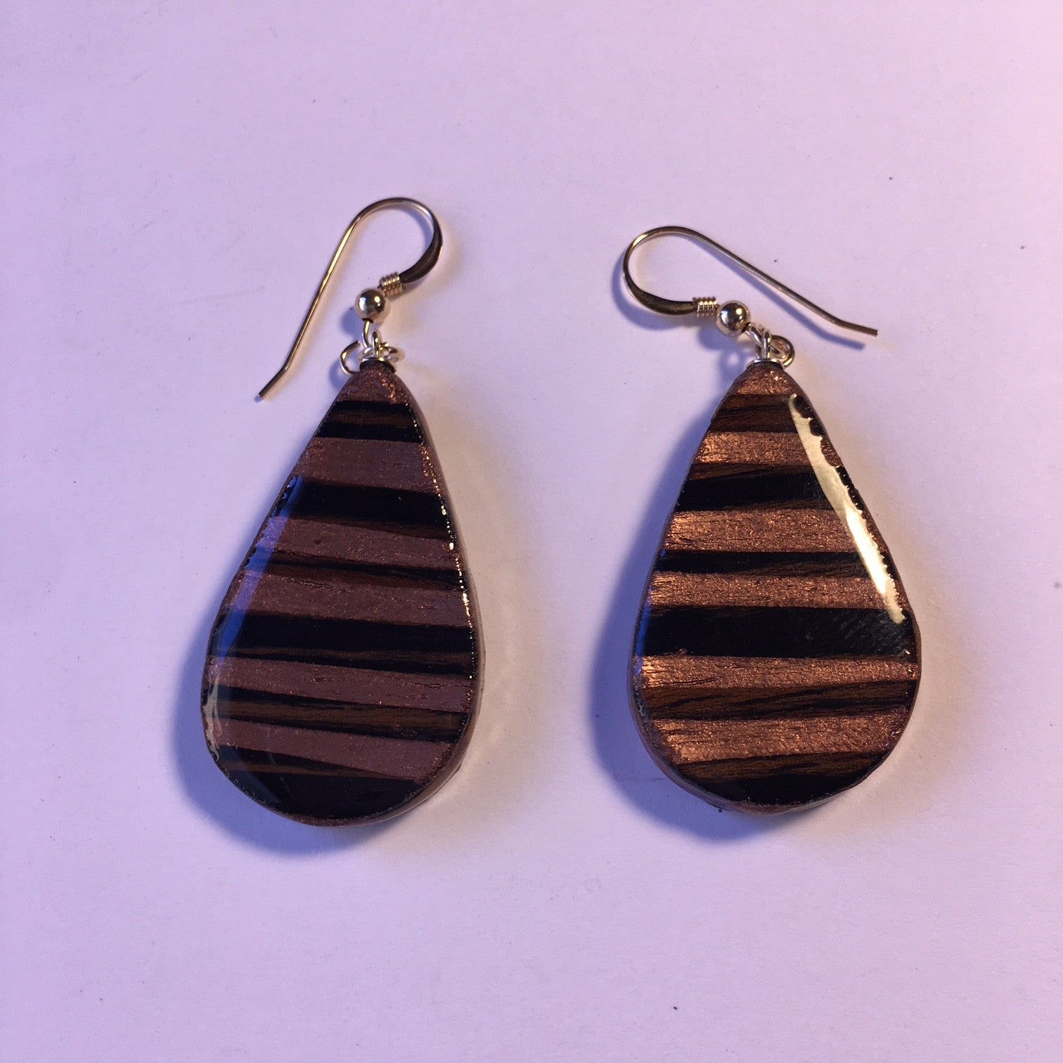 teardrop black and gold