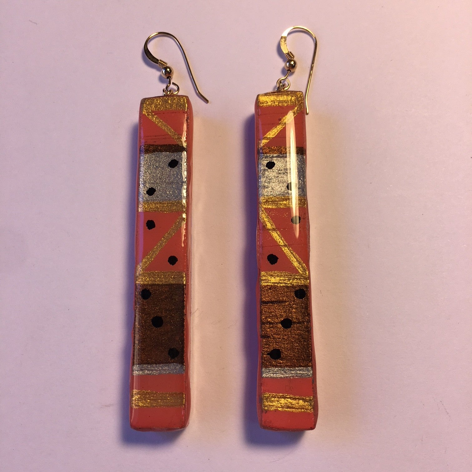 long rectangle with silver, gold, bronze,coral, and black dots