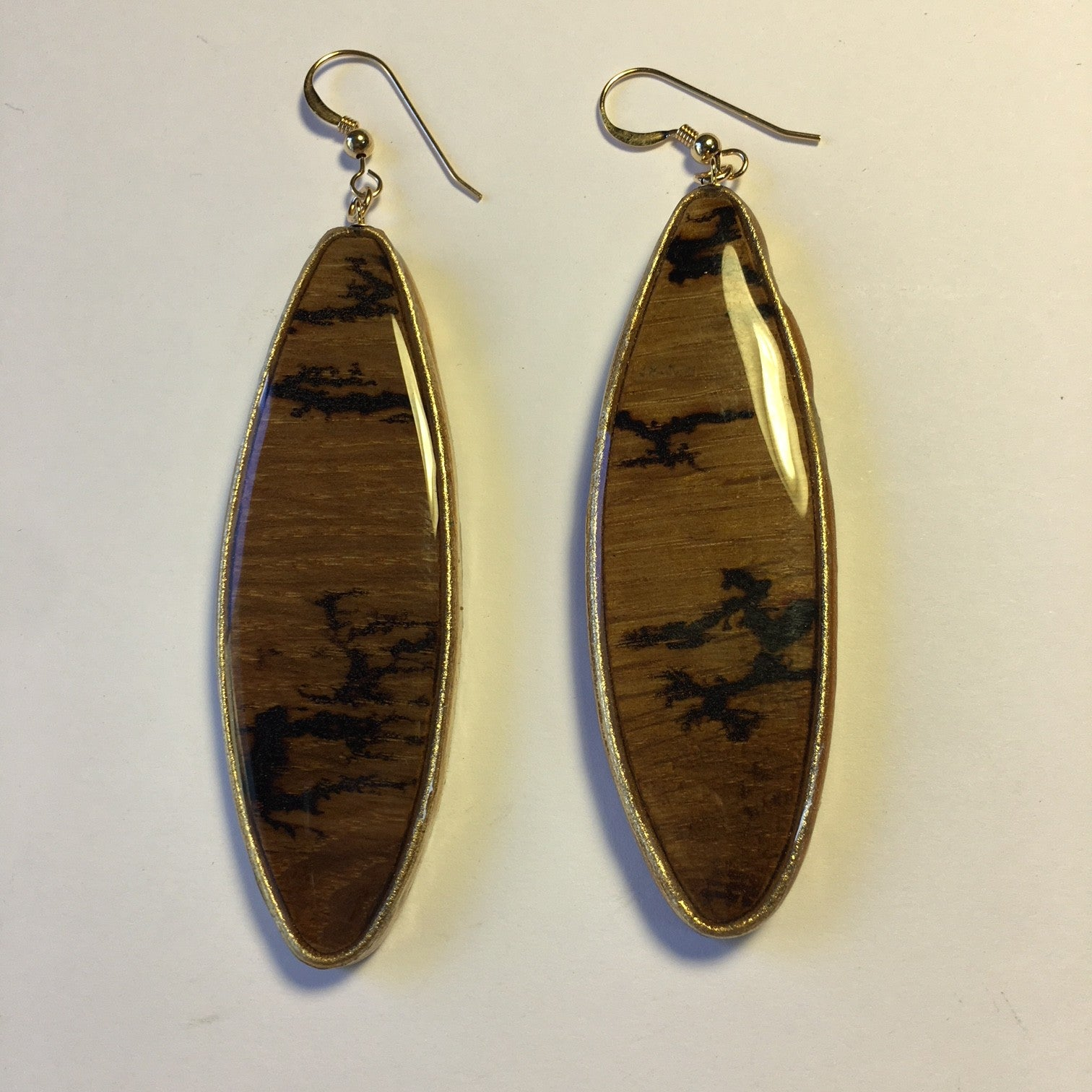 wood oval , tree image, gold leather around