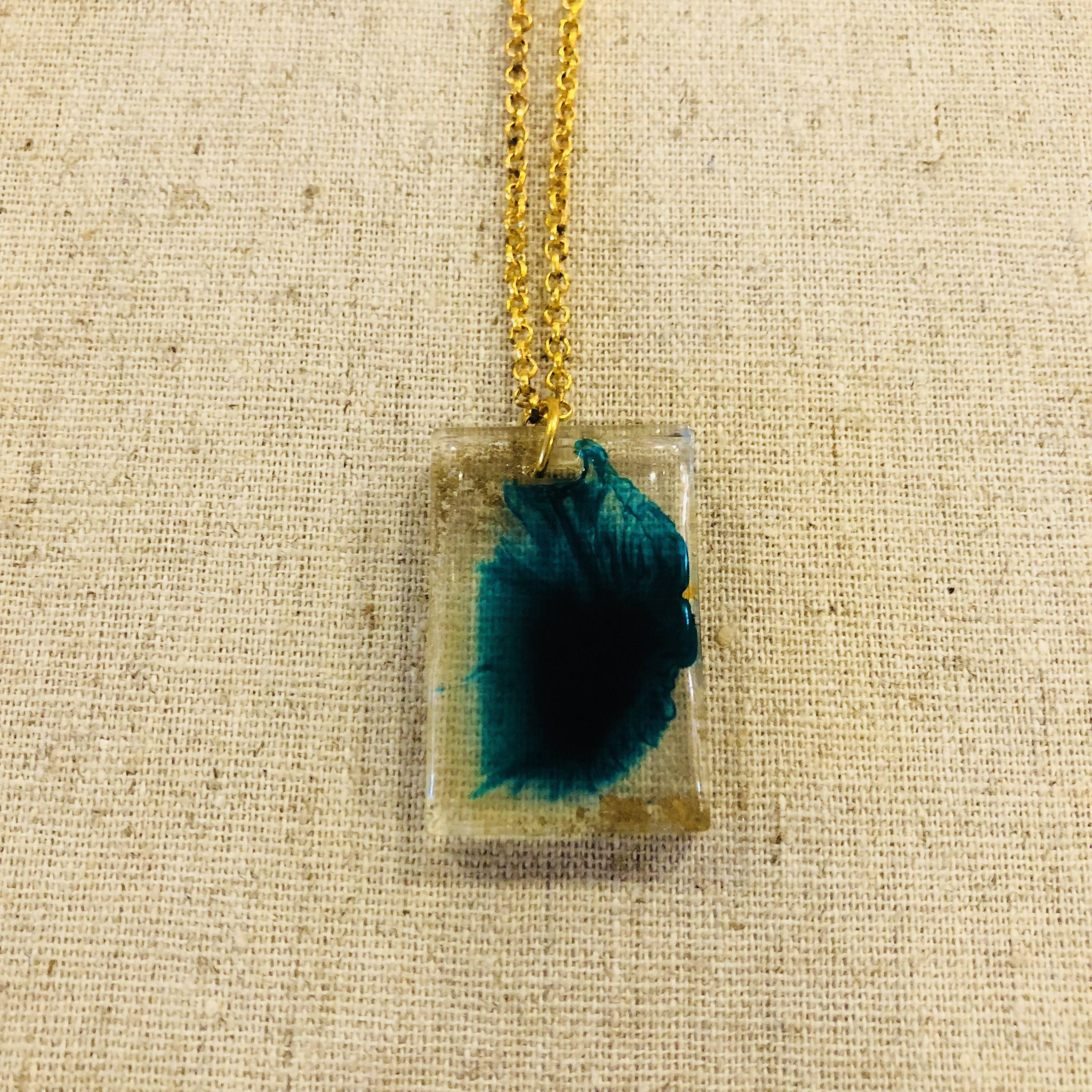 Beautiful teal feathery pendant necklace