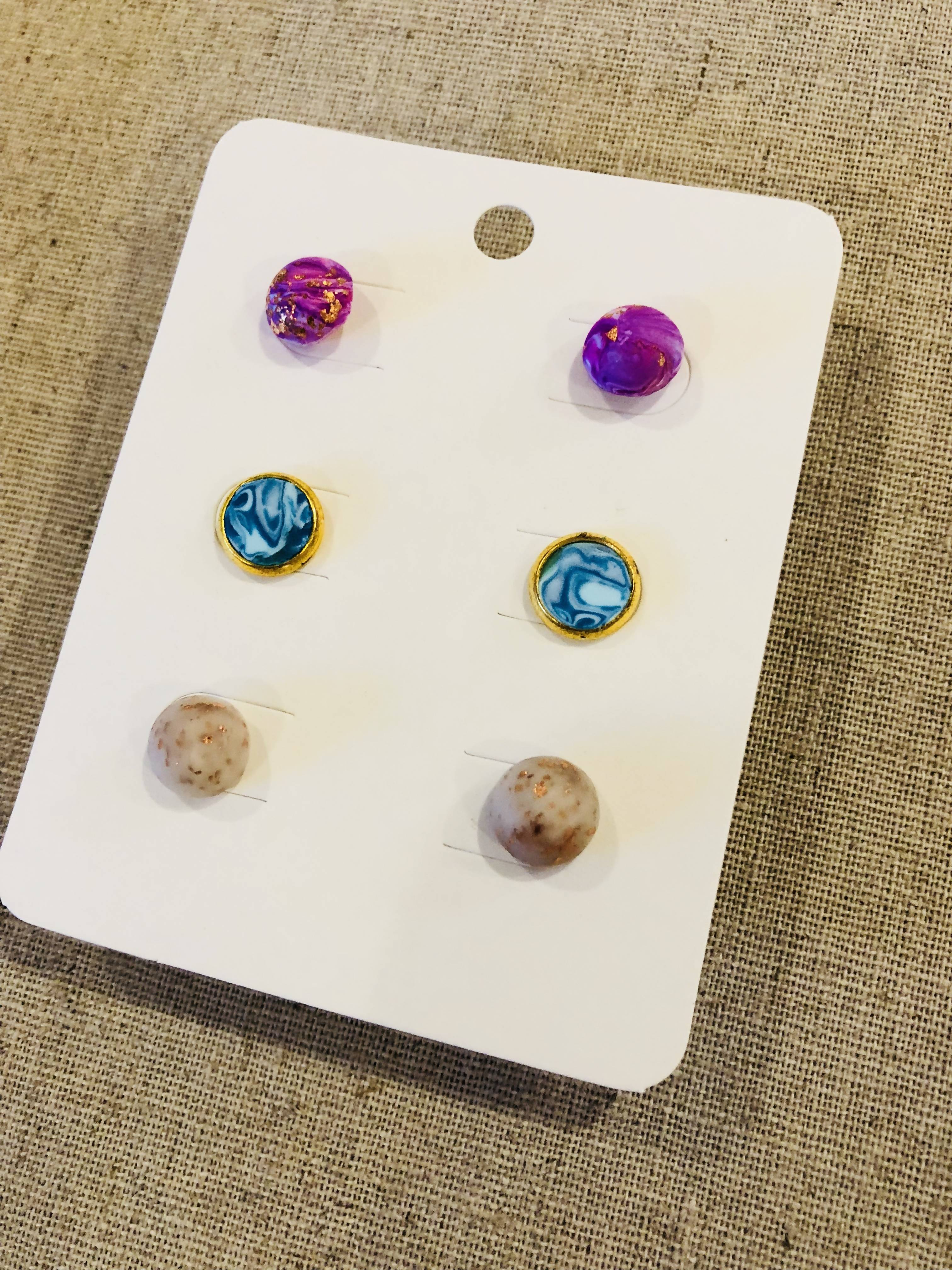 3 pairs of stud earrings - rose gold marble swirls, blue and white marbles and beige and rose gold rounds