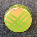 green and champagn round with crossing stripes