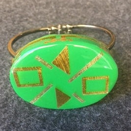 metal cuff green oval with gold and silver shapes