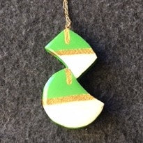 2 shapes attached, green, white gold